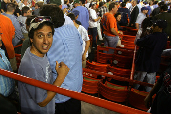 NEW YORK - OCTOBER 04:  Actor Ray Romano walks through the stands as the Los Angeles Dodgers take on the New York Mets in game one of the National League Division Series at Shea Stadium on October 4, 2006 in the Flushing neigborhood of Queens borough of N