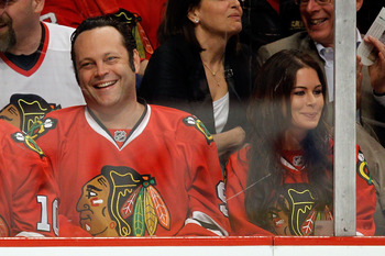 CHICAGO - MAY 21:  Actor Vince Vaughn and wife Kayla Weber cheer on the Blackhawks during the second period of Game Three of the Western Conference Finals during the 2010 NHL Stanley Cup Playoffs between the Chicago Blackhawks and the San Jose Sharks at t