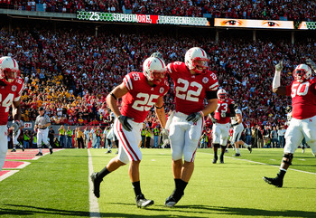 LINCOLN, NE - OCTOBER 30:  Running back Rex Burkhead #22 and  tight end Kyler Reed #25 of the Nebraska Cornhuskers celebrate a touchdown during first half action of their game at Memorial Stadium on October 30, 2010 in Lincoln, Nebraska. Nebraska Defeated