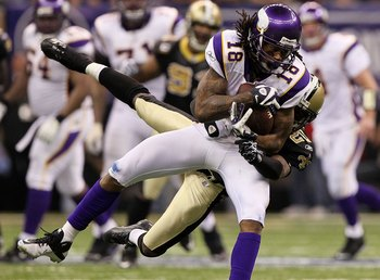 NEW ORLEANS - JANUARY 24:  Sidney Rice #18 of the Minnesota Vikings makes a reception against Randall Gay #20 of the New Orleans Saints during the NFC Championship Game at the Louisiana Superdome on January 24, 2010 in New Orleans, Louisiana. The Saints w