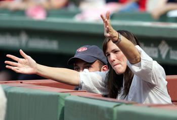 BOSTON - JUNE 2:  Actress Jennifer Garner reaches out to one of the Red Sox mascots before the Boston Red Sox host the New York Yankees on June 2, 2007 at Fenway Park in Boston, Massachusetts.  (Photo by Elsa/Getty Images)
