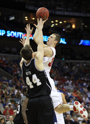 NEW ORLEANS, LA - MARCH 24:  Jon Leuer #30 of the Wisconsin Badgers goes up for a shot over Andrew Smith #44 of the Butler Bulldogs during the Southeast regional of the 2011 NCAA men's basketball tournament at New Orleans Arena on March 24, 2011 in New Or
