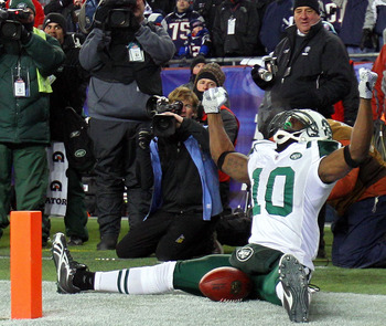 FOXBORO, MA - JANUARY 16:  Santonio Holmes #10 of the New York Jets celebrates his fourth quarter touchdown against the New England Patriots during their 2011 AFC divisional playoff game at Gillette Stadium on January 16, 2011 in Foxboro, Massachusetts.  