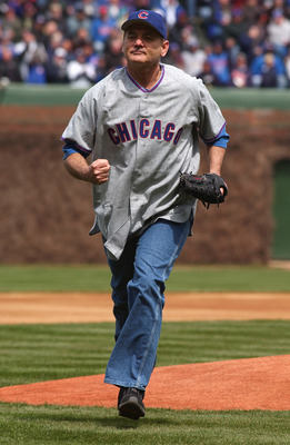CHICAGO - APRIL 12:  Actor Bill Murray runs to home plate after throwing the ceremonial first pitch prior to the Chicago Cubs home opener against the Pittsburgh Pirates on April 12, 2004 at Wrigley Field in Chicago, Illinois. The Pirates defeated the Cubs