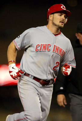 LOS ANGELES, CA - JUNE 13:  Chris Heisey #28 of the Cincinnati Reds rounds third base after hitting a home run in the sixth inning against pitcher Hiroki Kuroda #18 of the Los Angeles Dodgers (not in photo) during the MLB game at Dodger Stadium on June 13