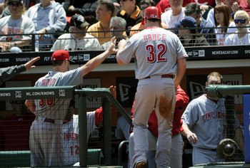 SAN FRANCISCO, CA - JUNE 11: Jay Bruce #32 of the Cincinnati Reds returns to the dugout after scoring and get a high five from teammate Travis Wood #30 against the San Francisco Giants during a MLB baseball game June 11, 2011 at AT&amp;T Park in San Francisco