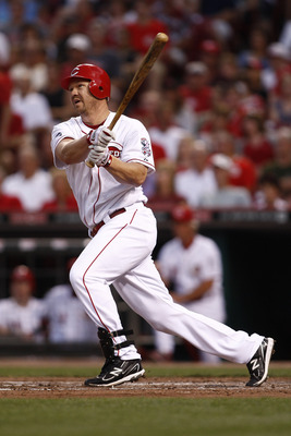 CINCINNATI, OH - JUNE 17:  Scott Rolen #27 of the Cincinnati Reds hits a solo home run during the game against the Toronto Blue Jays on June 17, 2011 at Great American Ball Park in Cincinnati, Ohio.  The Toronto Blue Jays defeated the Cincinnati Reds 3-2.