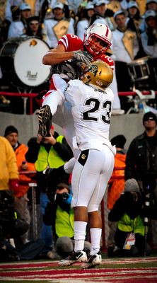 LINCOLN, NE - NOVEMBER 26: Kyler Reed #25 of the Nebraska Cornhuskers catches a touchdown over Jalil Brown #23 of the Colorado Buffaloes during the second half of their game at Memorial Stadium on November 26, 2010 in Lincoln, Nebraska. Nebraska defeated