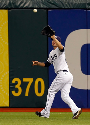 ST. PETERSBURG, FL - MAY 14:  Outfielder Matt Joyce #20 of the Tampa Bay Rays catches a fly ball against the Baltimore Orioles during the game at Tropicana Field on May 14, 2011 in St. Petersburg, Florida.  (Photo by J. Meric/Getty Images)