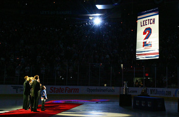 NEW YORK - JANUARY 24:  Former New York Ranger Brian Leetch stands with his family and friends as his banner is raised to the rafters before the game against the Atlanta Thrashers on January 24, 2008 at Madison Square Garden in New York City.Leetch became