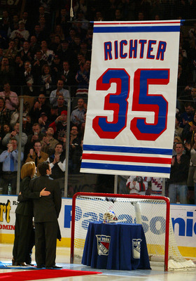 NEW YORK - FEBRUARY 4:  Former goalie of the New York Rangers Mike Richter and his wife Veronica watch his #35 jersey banner rises to the rafters as his jersey is retired at Madison Square Garden prior to the Rangers' game against the Minnesota Wild on Fe