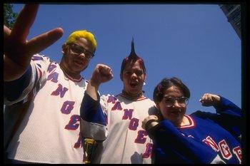 17 Jun 1994:  New York Rangers fans celebrate during a ticker tape parade in New York City, New York. Mandatory Credit: Al Bello  /Allsport