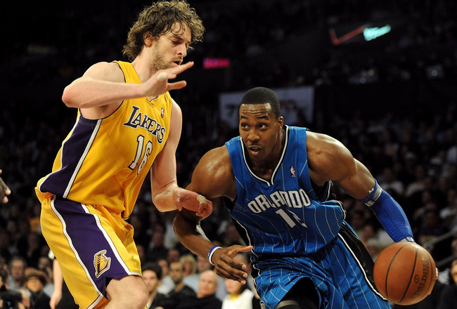LOS ANGELES, CA - JANUARY 18:  Dwight Howard #12 of the Orlando Magic drives against Pau Gasol #16 of the Los Angeles Lakers in the fourth quarter during the game on January 18, 2010 at Staples Center in Los Angeles, California. The Lakers won 98-92. NOTE