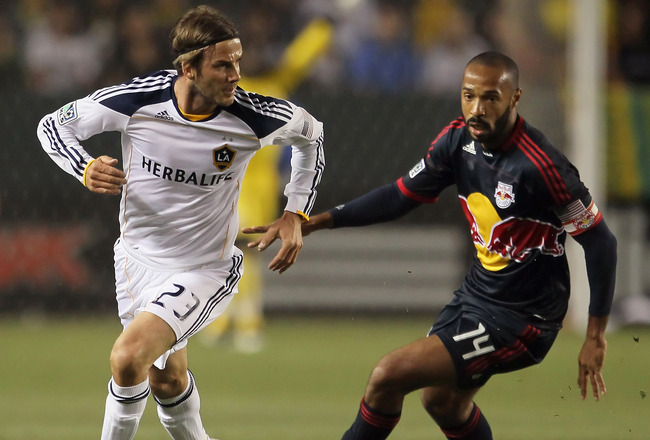 CARSON, CA - MAY 07:  David Beckham #23 of the Los Angeles Galaxy is pursued by Thierry Henry #14 of the New York Red Bulls in the first half at The Home Depot Center on May 7, 2011 in Carson, California. The Red Bulls and Galaxy played to a 1-1 draw.  (P