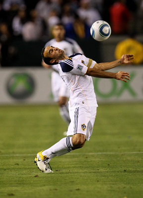 CARSON, CA - MAY 14:   Landon Donovan #10 of the Los Angeles Galaxy plays the ball off his chest against Sporting Kansas City at The Home Depot Center on May 14, 2011 in Carson, California.  The Galaxy won 4-1.  (Photo by Stephen Dunn/Getty Images)
