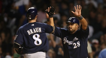 CHICAGO - AUGUST 29: Prince Fielder #28 of the Milwaukee Brewers greets teammate Ryan Braun #8 after Braun scored a run in the 7th inning against the Chicago Cubs on August 29, 2007 at Wrigley Field in Chicago, Illinois. (Photo by Jonathan Daniel/Getty Im