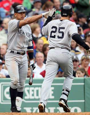 BOSTON - MAY 08:  Mark Teixeira #25 of the New York Yankees celebrates with teammate Alex Rodriguez #13 after Teixeira hit a solo home run in the fifth inning against the Boston Red Sox on May 8, 2010 at Fenway Park in Boston, Massachusetts.  (Photo by El