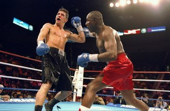4 Mar 1994:  Randall Yonker (left) trades punches with his opponent Mike McCallum during their fight in Las Vegas, Nevada.  McCallum won the bout with a TKO in the fifth round. Mandatory Credit: Al Bello  /Allsport