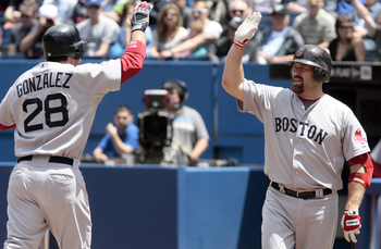TORONTO, CANADA - JUNE 12:  Adrian Gonzalez #28 and Kevin Youkilis #20 of the Boston Red Sox celebrate a home run during MLB action against the Toronto Blue Jays at The Rogers Centre June 12, 2011 in Toronto, Ontario, Canada. (Photo by Abelimages/Getty Im