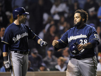 CHICAGO, IL - JUNE 15:  Ryan Braun # 8 of the Milwaukee Brewers and Prince Fielder #28 celebrate after scoring against the Chicago Cubs on June 15, 2011 at Wrigley Field in Chicago, Illinois.  (Photo by David Banks/Getty Images)