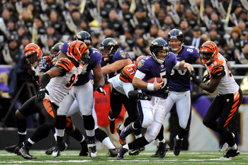 BALTIMORE, MD - JANUARY 2:  Joe Flacco #5 of the Baltimore Ravens is sacked by Roy Williams #31 of the Cincinnati Bengals  at M&T Bank Stadium on January 2, 2011 in Baltimore, Maryland. The Ravens defeated the Bengals 13-6. (Photo by Larry French/Getty Im