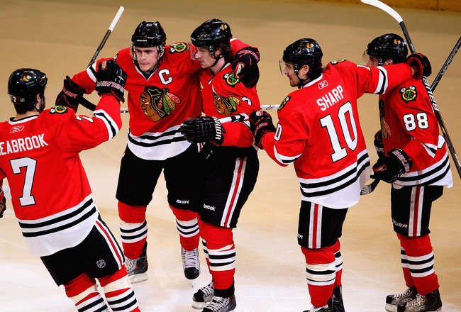 CHICAGO, IL - APRIL 17: (L-R) Brent Seabrook #7, Jonathan Toews #19, Duncan Keith #2, Patrick Sharp #10 and Patrick Kane #88 of the Chicago Blackhawks celebrate Keith's 1st period power-play goal against the Vancouver Canucks in Game Three of the Western