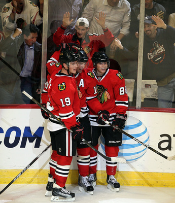 CHICAGO - OCTOBER 27: (L-R) Jonathan Toews #19, Patrick Sharp #10 and Patrick Kane #88 of the Chicago Blackhawks celebrate a 3rd period goal by Sharp against the Los Angeles Kings at the United Center on October 27, 2010 in Chicago, Illinois. The Blackhaw