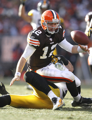CLEVELAND, OH - JANUARY 02:  Quarterback Colt McCoy #12 of the Cleveland Browns fumbles the ball after being hit by defensive end Brett Keisel #99 of the Pittsburgh Steelers at Cleveland Browns Stadium on January 2, 2011 in Cleveland, Ohio.  (Photo by Mat