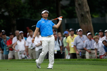BETHESDA, MD - JUNE 18:  Y.E. Yang of South Korea watches his approach shot on the 18th hole during the third round of the 111th U.S. Open at Congressional Country Club on June 18, 2011 in Bethesda, Maryland.  (Photo by Rob Carr/Getty Images)
