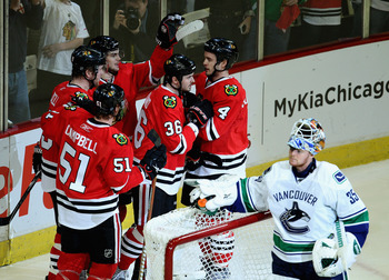 CHICAGO, IL - APRIL 24: (L-R) Brian Campbell #51, Bryan Bickell #29, Michael Frolik #67, Dave Bolland #36 and Niklas Hjalmarsson #4 of the Chicago Blackhawks celebrate a 1st period goal against Cory Schneider #35 of the Vancouver Canucks in Game Six of th
