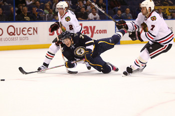 ST. LOUIS - OCTOBER 22: T.J. Oshie #74 of the St. Louis Blues is tripped up by Duncan Keith #2 and Brent Seabrook #7 both of the Chicago Blackhawks at the Scottrade Center on October 22, 2010 in St. Louis, Missouri.  (Photo by Dilip Vishwanat/Getty Images