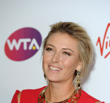 LONDON, ENGLAND - JUNE 16:  Maria Sharapova arrives at the WTA Tour Pre-Wimbledon Party at The Roof Gardens, Kensington on June 16, 2011 in London, England.  (Photo by Gareth Cattermole/Getty Images for WTA)