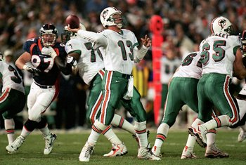 13 Sep 1999: Quarterback Dan Marino #13 of the Miami Dolphins passes the ball during the game against the Denver Broncos at the Mile High Stadium in Denver, Colorado. The Dolphins defeated the Broncos 38-21. Mandatory Credit: Brian Bahr  /Allsport