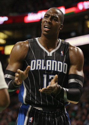 BOSTON, MA - JANUARY 17:  Dwight Howard #12 of the Orlando Magic reacts to a call in the first quarter as they take on the Boston Celtics on January 17, 2011 at the TD Garden in Boston, Massachusetts.  NOTE TO USER: User expressly acknowledges and agrees