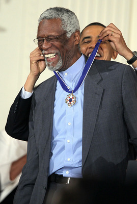 WASHINGTON, DC - FEBRUARY 15:  Former Boston Celtics captain Bill Russell (L) is presented with the 2010 Medal of Freedom by U.S. President Barack Obama during an East Room event at the White House February 15, 2011 in Washington, DC. Obama presented the