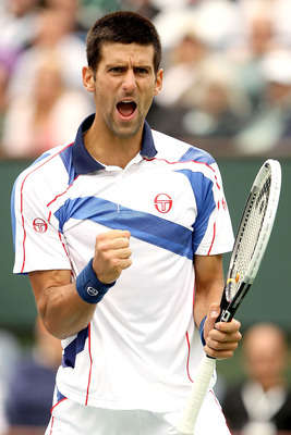INDIAN WELLS, CA - MARCH 20:  Novak Djokovic of Serbia celebrates a point against Rafael Nadal of Spain during the final of the BNP Paribas Open at the Indian Wells Tennis Garden on March 20, 2011 in Indian Wells, California.  (Photo by Matthew Stockman/G