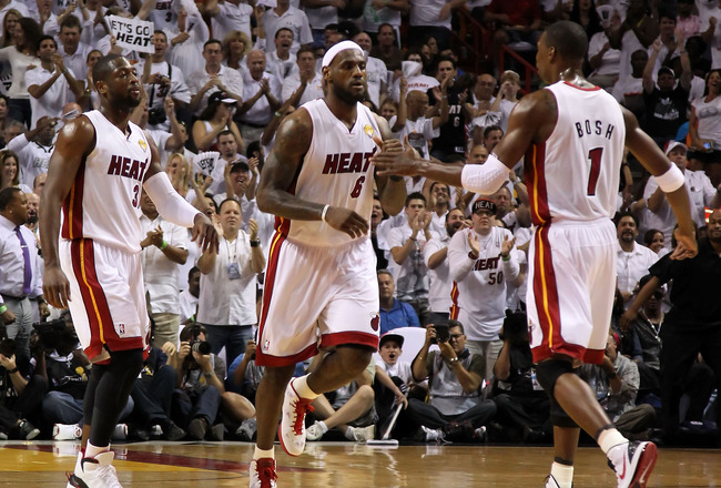 MIAMI, FL - JUNE 12:  (L-R) Dwyane Wade #3, LeBron James #6 and Chris Bosh #1 of the Miami Heat react on court against the Dallas Mavericks in Game Six of the 2011 NBA Finals at American Airlines Arena on June 12, 2011 in Miami, Florida. NOTE TO USER: Use