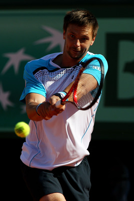 PARIS, FRANCE - JUNE 01:  Robin Soderling of Swedenhits a backhand during the men's singles quarterfinal match between Rafael Nadal of Spain and Robin Soderling of Sweden on day eleven of the French Open at Roland Garros on June 1, 2011 in Paris, France.