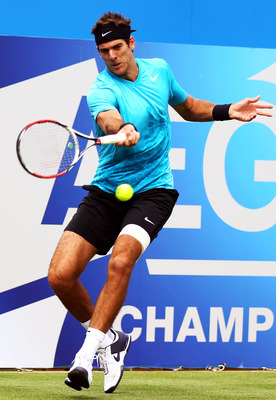 LONDON, ENGLAND - JUNE 07:  Juan Martin del Potro of Argentina returns a shot during his Men's Singles first round match against Denis Istomin of Uzbekistan on day two of the AEGON Championships at Queens Club on June 7, 2011 in London, England.  (Photo b