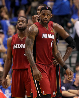DALLAS, TX - JUNE 07:  (L-R) Dwyane Wade #3, Chris Bosh #1 and LeBron James #6 of the Miami Heat look on against the Dallas Mavericks  in Game Four of the 2011 NBA Finals at American Airlines Center on June 7, 2011 in Dallas, Texas. NOTE TO USER: User exp
