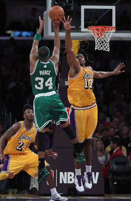 LOS ANGELES, CA - JANUARY 30:  Paul Pierce #34 of the Boston Celtics shoots over Andrew Bynum #17 of the Los Angeles Lakers in the first half at Staples Center on January 30, 2011 in Los Angeles, California. The Celtics defeated the Lakers 109-96.  (Photo
