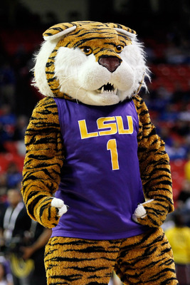ATLANTA, GA - MARCH 10:  Mascot Mike the Tiger of the LSU Tigers cheers during their game against the Vanderbilt Commodores in the first round of the SEC Men's Basketball Tournament at the Georgia Dome on March 10, 2011 in Atlanta, Georgia.  (Photo by Kev