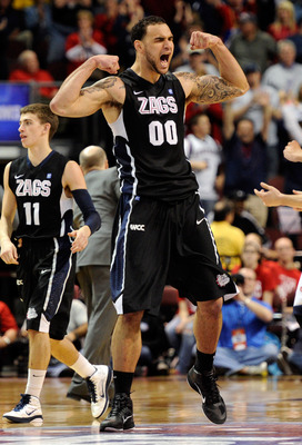 LAS VEGAS, NV - MARCH 07:  Robert Sacre #00 of the Gonzaga Bulldogs celebrates late in the team's 75-63 victory over the Saint Mary's Gaels in the championship game of the Zappos.com West Coast Conference Basketball tournament at the Orleans Arena March 7