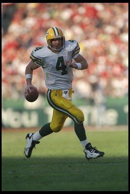 6 Jan 1996:  Quarterback Brett Favre of the Green Bay Packers runs down the field during a playoff game against the San Francisco 49ers at 3Com Park in San Francisco, California.  The Packers won the game 27-17. Mandatory Credit: Otto Greule Jr.  /Allspor