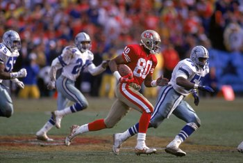 SAN FRANCISCO - JANUARY 17:  Wide receiver Jerry Rice #80 of the San Francisco 49ers finds room to run against the Dallas Cowboys defense during the 1992 NFC Championship Game at Candlestick Park on January 17, 1993 in San Francisco, California.  The Cowb