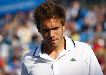 LONDON, ENGLAND - JUNE 07:  Nicolas Mahut of France reacts during his Men's Singles first round match against Fernando Verdasco of Spain on day two of the AEGON Championships at Queens Club on June 7, 2011 in London, England.  (Photo by Clive Brunskill/Ge