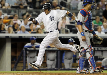 NEW YORK, NY - JUNE 15:  Andruw Jones #18 of the New York Yankees scores a fifth inning run against the Texas Rangers on June 15, 2011 at Yankee Stadium in the Bronx borough of New York City.  (Photo by Jim McIsaac/Getty Images)