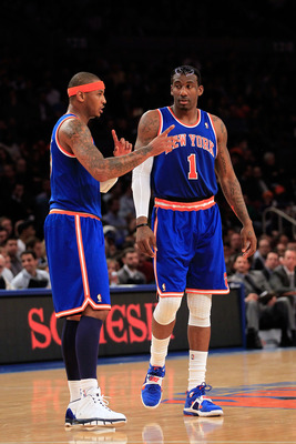 NEW YORK, NY - FEBRUARY 23: (L-R) Carmelo Anthony #7 and Amar'e Stoudemire #1 of the New York Knicks discuss tactics on the court against the Milwaukee Bucks at Madison Square Garden on February 23, 2011 in New York City. NOTE TO USER: User expressly ackn