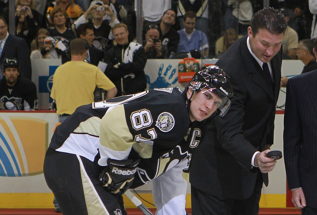 PITTSBURGH - OCTOBER 07:  Team owner Mario Lemieux of the Pittsburgh Penguins drops the puck between Sidney Crosby #87 and Mike Richards #18 of the Philadelphia Flyers as NHL commissioner Gary Bettman looks on prior to the arena opening game  at the Conso