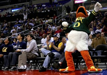 LOS ANGELES, CA - MARCH 09:  The mascot for the Oregon Ducks celebrates as the Ducks make a comeback in the second half against the Washington Huskies in the quarterfinals of the 2006 Pacific Life Pac-10 Men's Basketball Tournament on March 9, 2006 at Sta